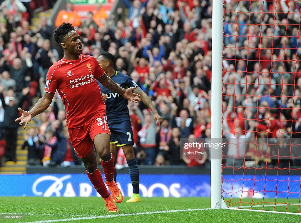Raheem Sterling of Liverpool celebrates his goal during the Premier League match between Liverpool and Southampton at Anfield on August 17, 2014 in Liverpool, England.