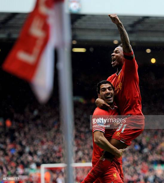 Raheem Sterling of Liverpool celebrates his goal with Luis Suarez during the Barclays Premier League match between Liverpool and Arsenal at Anfield...