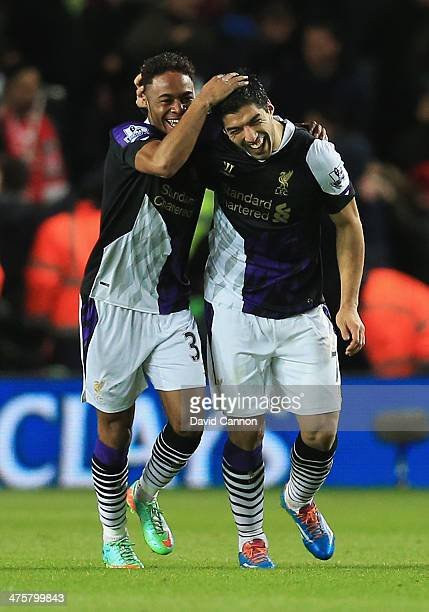Raheem Sterling of Liverpool celebrates his goal with Luis Suarez during the Barclays Premier League match between Southampton and Liverpool at St...