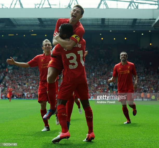 Raheem Sterling of Liverpool celebrates his goal with Steven Gerrard during the Pre Season Friendly between Liverpool and Bayer Leverkusen at Anfield...