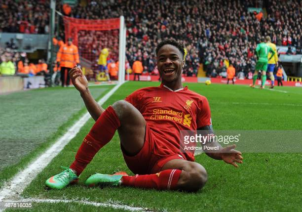 Raheem Sterling of Liverpool celebrates his second goal during the Barclays Premier League match between Liverpool and Arsenal at Anfield on February...
