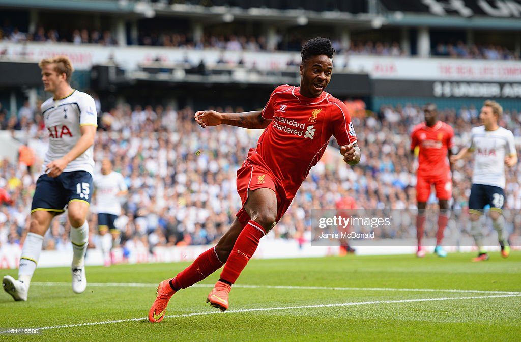 Raheem Sterling of Liverpool celebrates scoring the opening goal during the Barclays Premier League match between Tottenham Hotspur and Liverpool at White Hart Lane on August 31, 2014 in London, England.