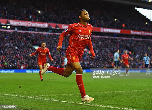 Raheem Sterling of Liverpool celebrates scoring the opening goal during the Barclays Premier League match between Liverpool and West Ham United at...