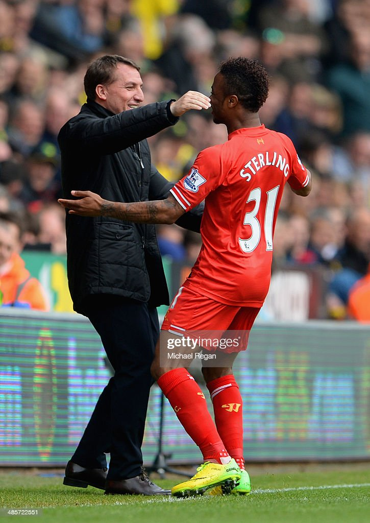 Raheem Sterling of Liverpool celebrates scoring the opening goal with Manager Brendan Rodgers of Liverpool during the Barclays Premier League match between Norwich City and Liverpool at Carrow Road on April 20, 2014 in Norwich, England.