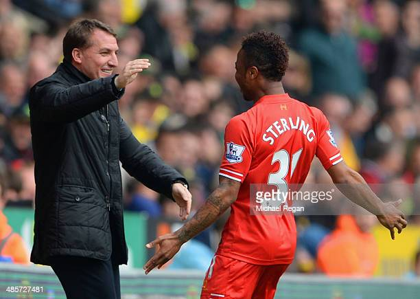 Raheem Sterling of Liverpool celebrates scoring the opening goal with Manager Brendan Rodgers of Liverpool during the Barclays Premier League match...