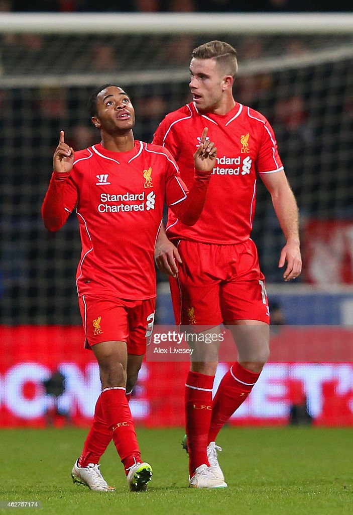 Raheem Sterling of Liverpool (L) celebrates scoring their first goal with Jordan Henderson of Liverpool during the FA Cup Fourth round replay between Bolton Wanderers and Liverpool at Macron Stadium on February 4, 2015 in Bolton, England.