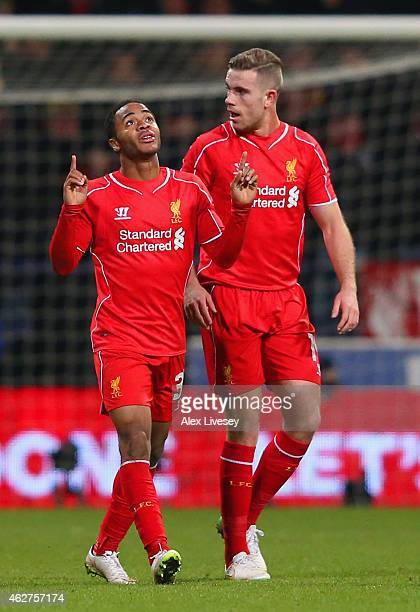 Raheem Sterling of Liverpool celebrates scoring their first goal with Jordan Henderson of Liverpool during the FA Cup Fourth round replay between...