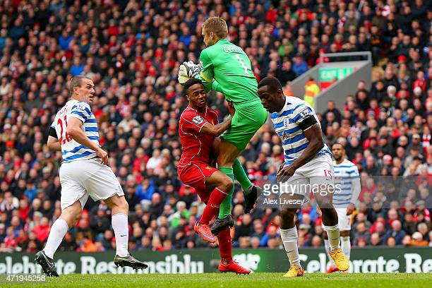 Raheem Sterling of Liverpool collides with Robert Green of QPR during the Barclays Premier League match between Liverpool and Queens Park Rangers at...