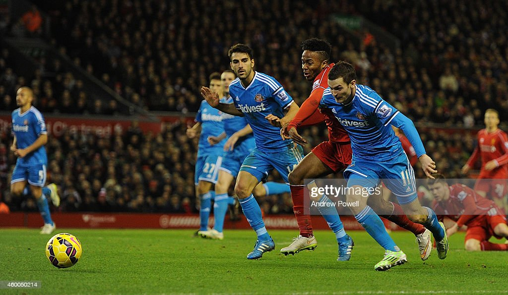 Raheem Sterling of Liverpool competes with Adam Johnson of Sunderland during the Barclays Premier League match between Liverpool and Sunderland at Anfield on December 6, 2014 in Liverpool, England.