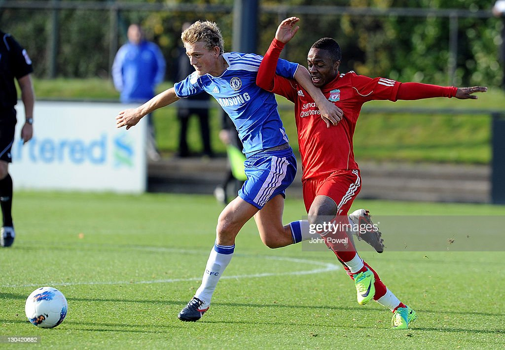 Raheem Sterling of Liverpool competes with George Saville of Chelsea during the Barclays Premier Reserve League match between Liverpool Reserves and Chelsea Reserves on October 26, 2011 in Liverpool, England.