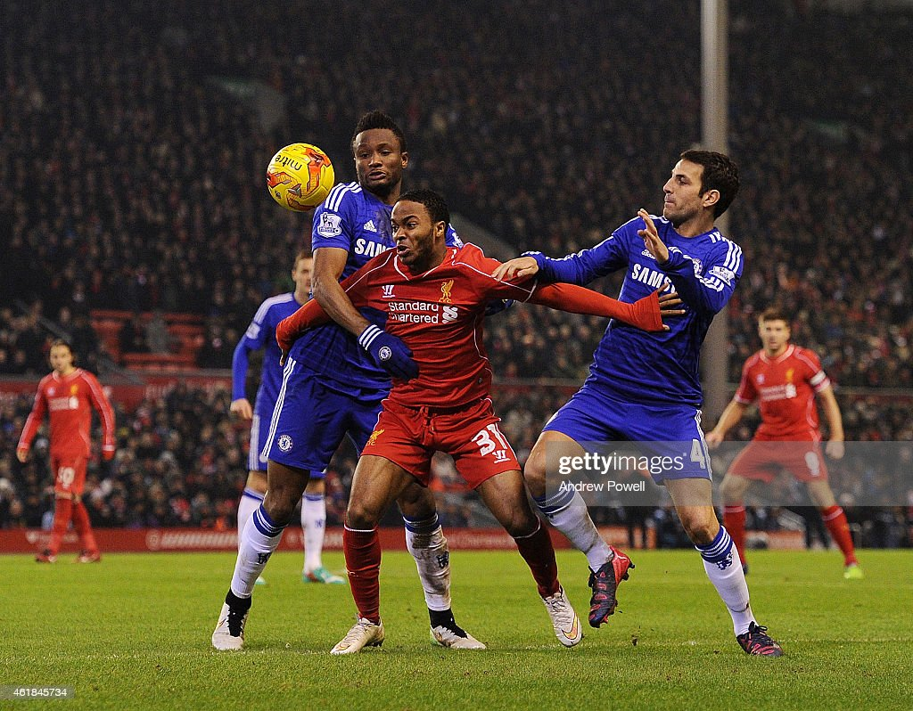 Raheem Sterling of Liverpool competes with John Obi Mikel and Cesc Fabregas of Chelsea during the Capital One Cup Semi-Final First Leg between Liverpool and Chelsea at Anfield on January 20, 2015 in Liverpool, England.