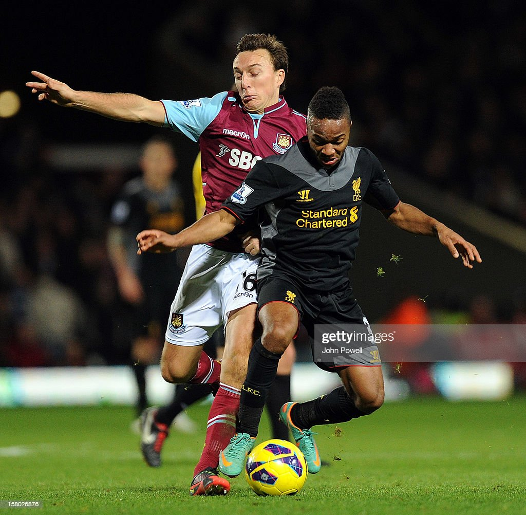 Raheem Sterling (R) of Liverpool competes with Mark Noble of West Ham United during the Barclays Premier League match between West Ham United and Liverpool at Boleyn Ground on December 9, 2012 in London, England.