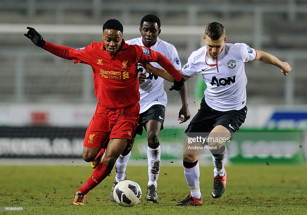 Raheem Sterling of Liverpool competes with Michele Fornasier of Manchester United Reserves during the Barclays Premier Reserve League match between Liverpool Reserves and Manchester United at Langtree Park on February 25, 2013 in St Helens, England.