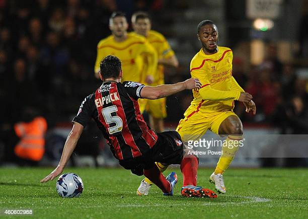 Raheem Sterling of Liverpool competes with Tommy Elphick of Bournemouth during the Capital One Cup QuarterFinal match between Bournemouth and...