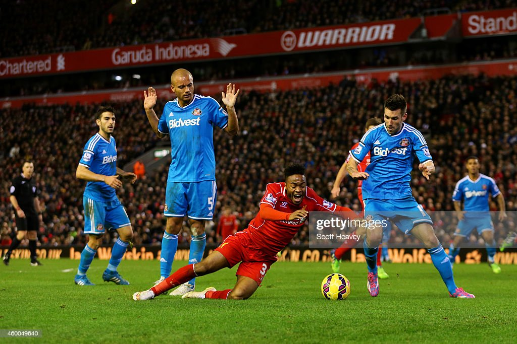 Raheem Sterling of Liverpool goes down in the penalty area during the Barclays Premier League match between Liverpool and Sunderland at Anfield on December 6, 2014 in Liverpool, England.