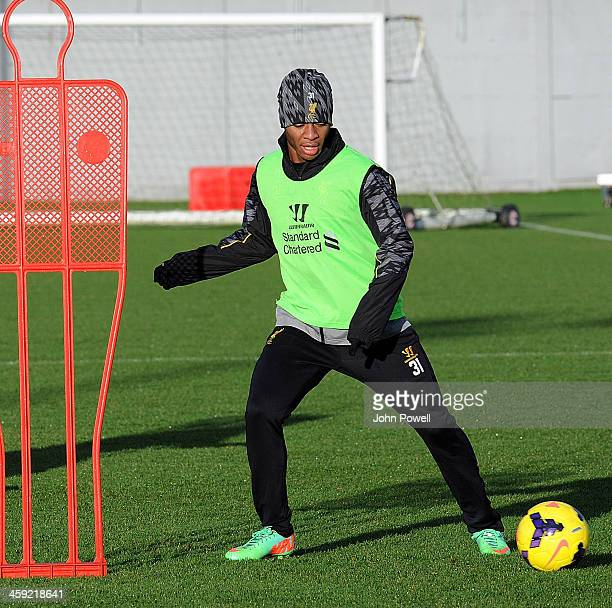 Raheem Sterling of Liverpool in action during a training session at Melwood Training Ground on December 24 2013 in Liverpool England