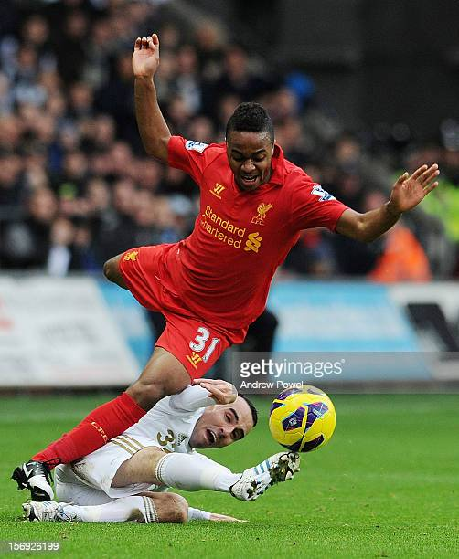 Raheem Sterling of Liverpool is brought down by Leon Britton of Swansea City during the Barclays Premier League match between Swansea City and...