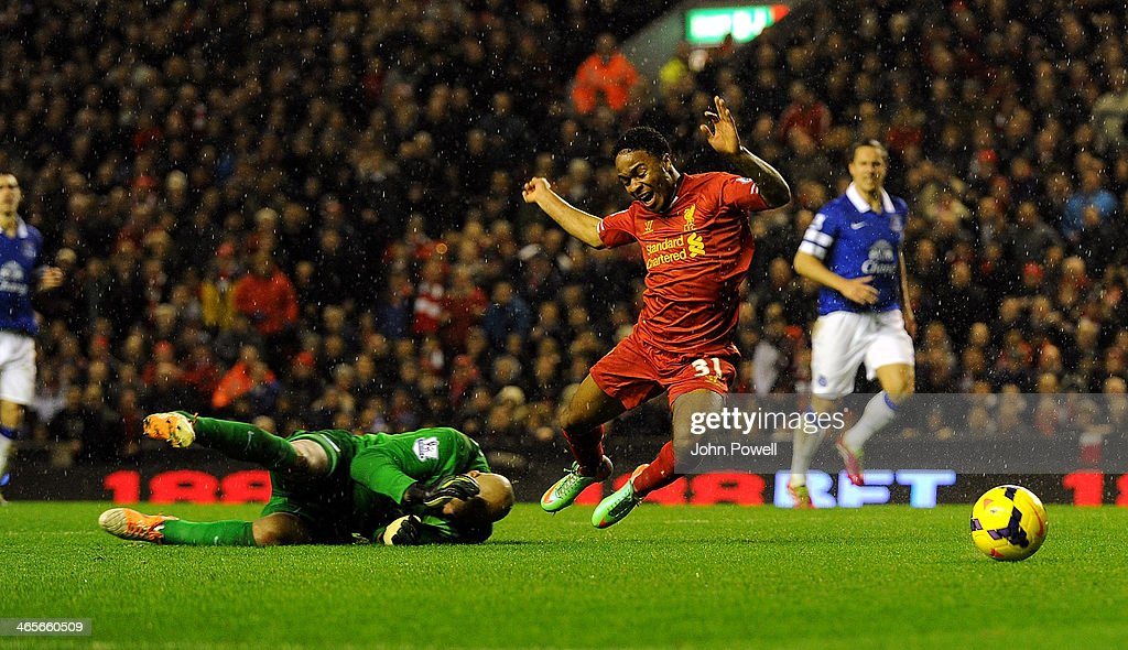 Raheem Sterling of Liverpool is brought down for a penalty by Tim Howard of Everton during the Barclays Premier League match between Liverpool and Everton at Anfield on January 28, 2014 in Liverpool, England.