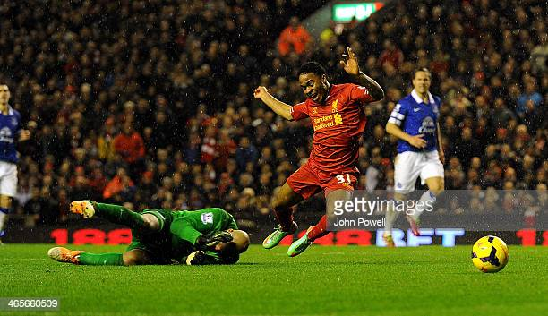 Raheem Sterling of Liverpool is brought down for a penalty by Tim Howard of Everton during the Barclays Premier League match between Liverpool and...