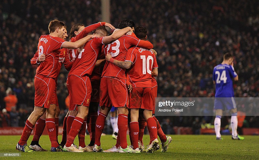 Raheem Sterling of Liverpool is congratulated after his goal during the Capital One Cup Semi-Final First Leg between Liverpool and Chelsea at Anfield on January 20, 2015 in Liverpool, England.