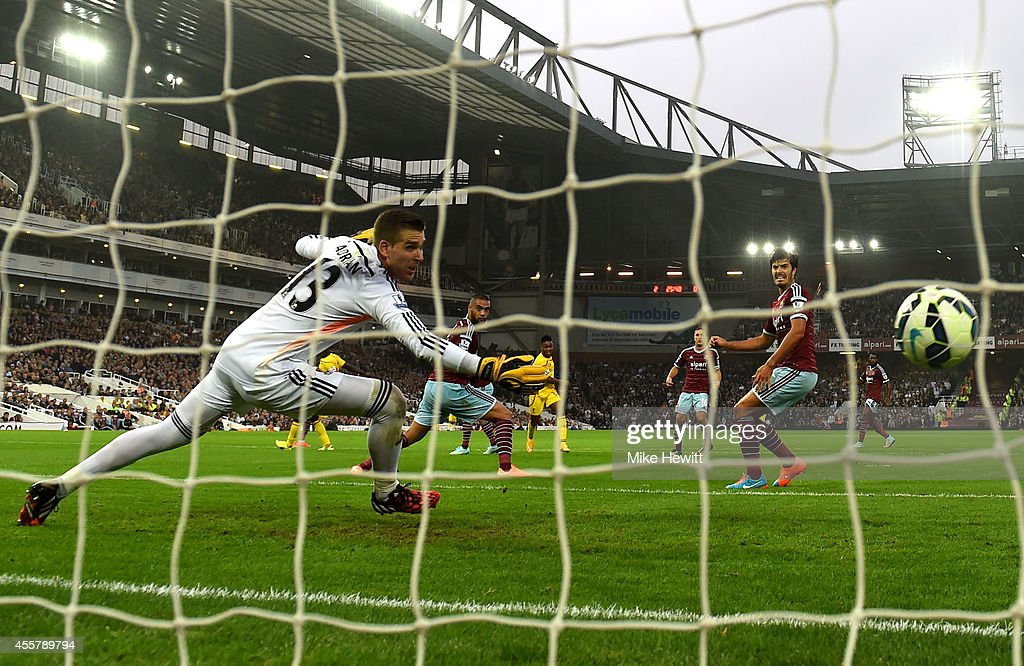 Raheem Sterling of Liverpool scores his team's first goal past goalkeeper Adrian of West Ham during the Barclays Premier League match between West Ham United and Liverpool at Boleyn Ground on September 20, 2014 in London, England.