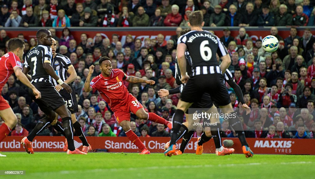 Raheem Sterling of Liverpool scores the first goal during the Barclays Premier League match between Liverpool and Newcastle United at Anfield on April 13, 2015 in Liverpool, England.