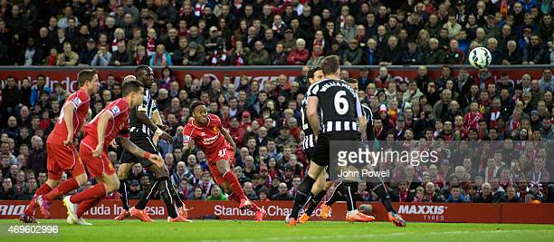 Raheem Sterling of Liverpool scores the first goal during the Barclays Premier League match between Liverpool and Newcastle United at Anfield on...
