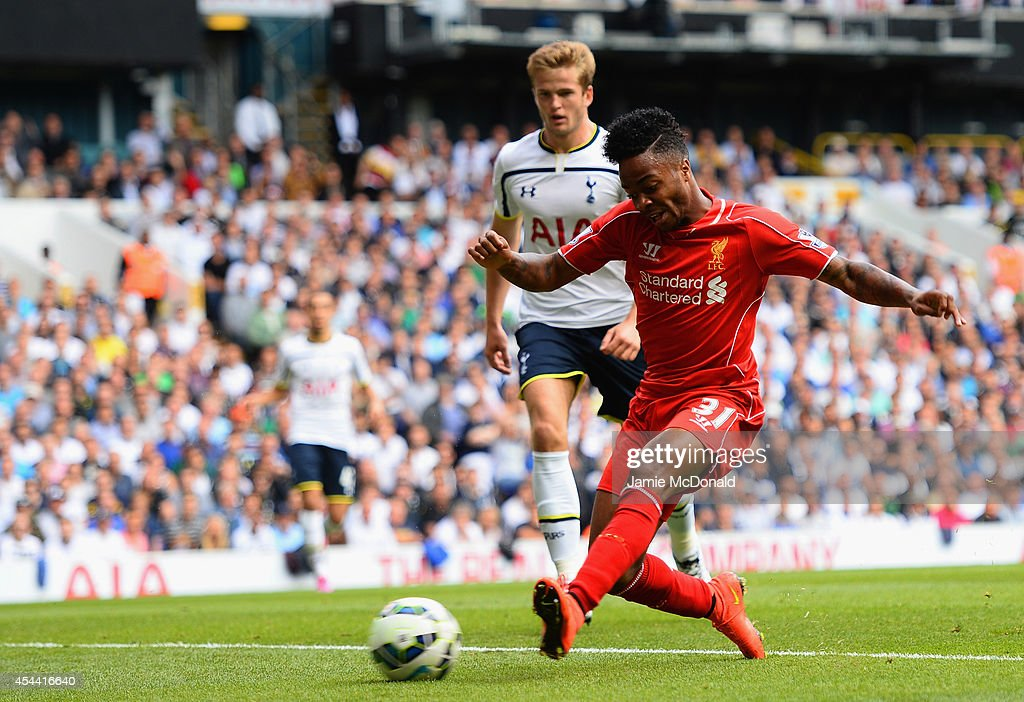 Raheem Sterling of Liverpool scores the opening goal during the Barclays Premier League match between Tottenham Hotspur and Liverpool at White Hart Lane on August 31, 2014 in London, England.