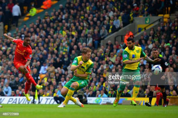 Raheem Sterling of Liverpool scores the opening goal during the Barclays Premier League match between Norwich City and Liverpool at Carrow Road on...