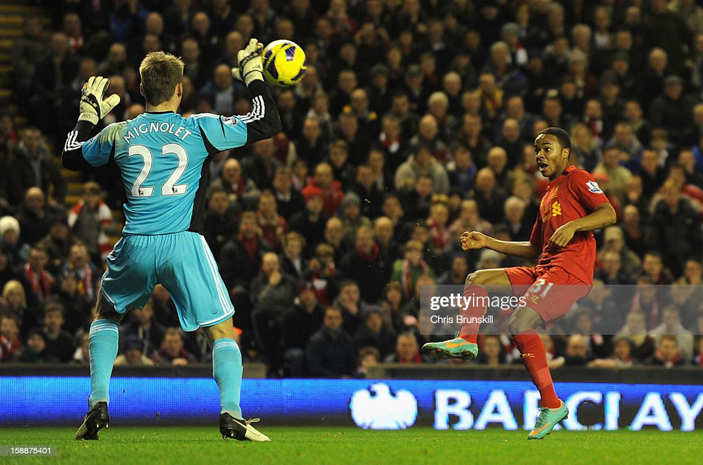Raheem Sterling of Liverpool scores the opening goal past Simon Mignolet of Sunderland during the Barclays Premier League match between Liverpool and Sunderland at Anfield on January 2, 2013 in Liverpool, England.