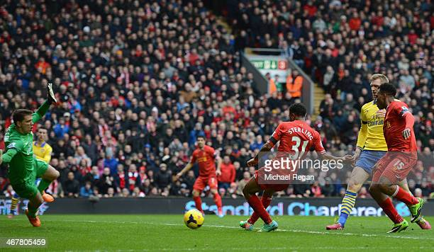 Raheem Sterling of Liverpool scores the third goal during the Barclays Premier League match between Liverpool and Arsenal at Anfield on February 8...