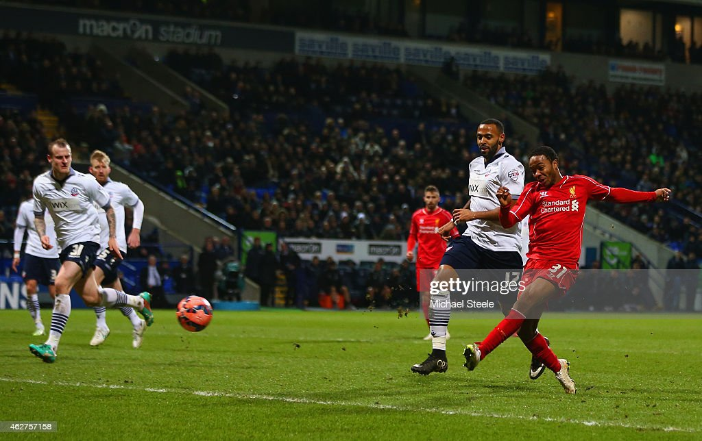 Raheem Sterling of Liverpool scores their first goal during the FA Cup Fourth round replay between Bolton Wanderers and Liverpool at Macron Stadium on February 4, 2015 in Bolton, England.