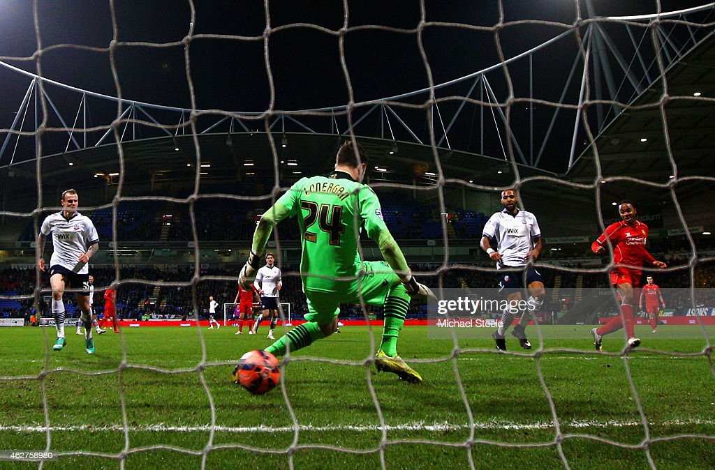 Raheem Sterling of Liverpool scores their first goal past Andy Lonergan of Bolton Wanderers during the FA Cup Fourth round replay between Bolton Wanderers and Liverpool at Macron Stadium on February 4, 2015 in Bolton, England.
