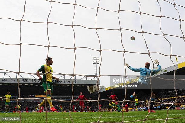 Raheem Sterling of Liverpool scores their third goal past John Ruddy of Norwich City during the Barclays Premier League match between Norwich City...
