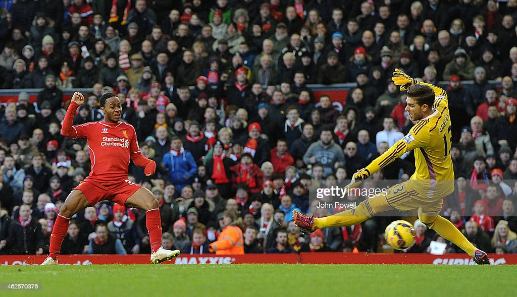Raheem Sterling of Liverpool scores to make it 1-0 during the Barclays Premier League match between Liverpool and West Ham United at Anfield on January 31, 2015 in Liverpool, England.