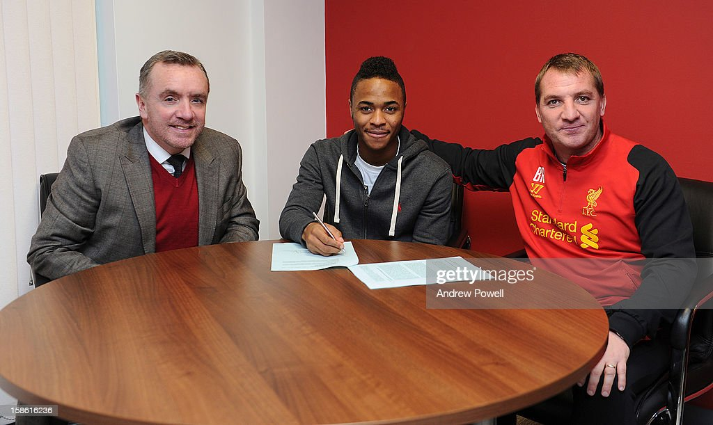 (MINIMUM USAGE FEE APPLIES - 150 GBP FOR PRINT AND GBP 75 ONLINE OR LOCAL EQUIVALENT) Raheem Sterling of Liverpool signs a new contract with Ian Ayre (L) managing director and Brendan Rodgers (R) manager Liverpool FC at Melwood Training Ground on December 21, 2012 in Liverpool, England.