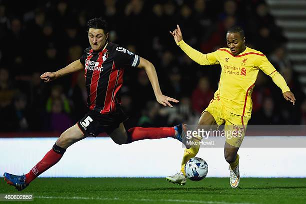 Raheem Sterling of Liverpool takes on Tommy Elphick of Bournemouth on the way to scoring his second goal during the Capital One Cup QuarterFinal...