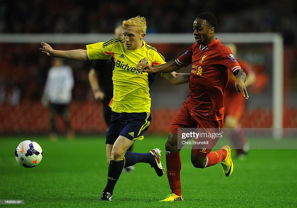 Raheem Sterling of Liverpool U21 in action with Liam Marrs of Sunderland U21 during the Barclays U21s Premier League match between Liverpool U21 and Sunderland U21 at Anfield on September 17, 2013 in Liverpool, England.
