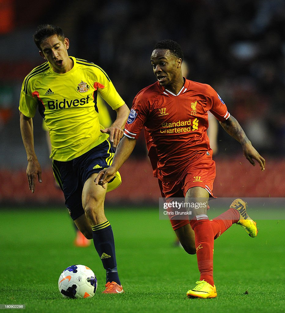 Raheem Sterling of Liverpool U21 races away from David Moberg Karlsson of Sunderland U21 during the Barclays U21s Premier League match between Liverpool U21 and Sunderland U21 at Anfield on September 17, 2013 in Liverpool, England.