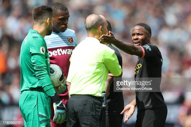 Raheem Sterling of Man City argues with referee Mike Dean after their 3rd goal is disallowed by VAR during the Premier League match between West Ham...