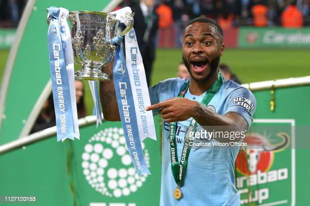 Raheem Sterling of Man City poses with the trophy during the Carabao Cup Final between Chelsea and Manchester City at Wembley Stadium on February 24,...