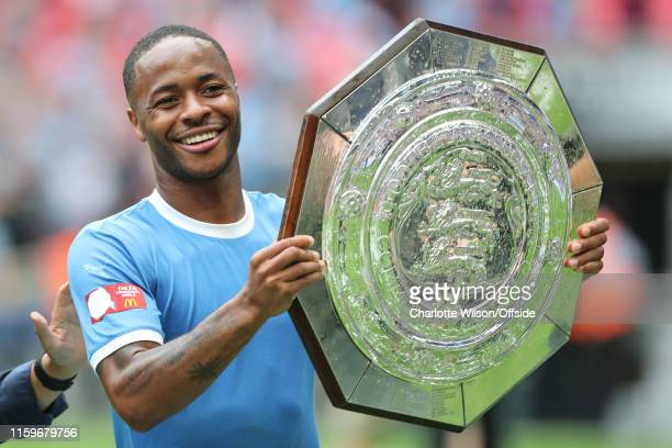 Raheem Sterling of Man City poses with the trophy during the FA Community Shield between Liverpool and Manchester City at Wembley Stadium on August 4...