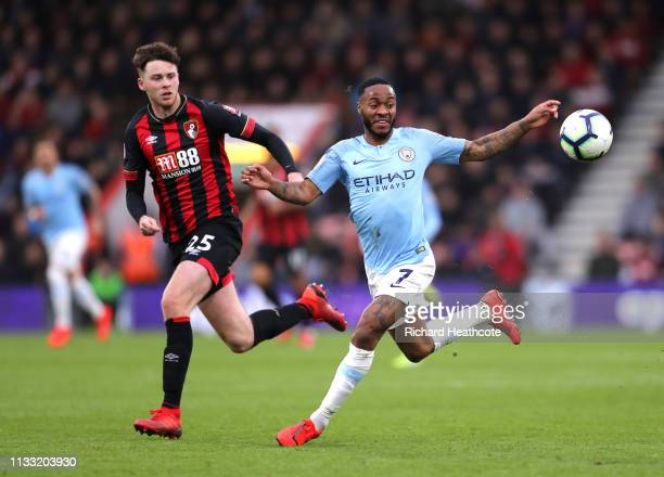 Raheem Sterling of Mancheste City is challenged by Jack Simpson of AFC Bournemouth during the Premier League match between AFC Bournemouth and...