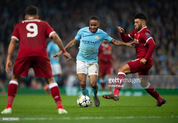 Raheem Sterling of Manchester City and Alex OxladeChamberlain of Liverpool in action during the UEFA Champions League quarter final 2nd leg tie...