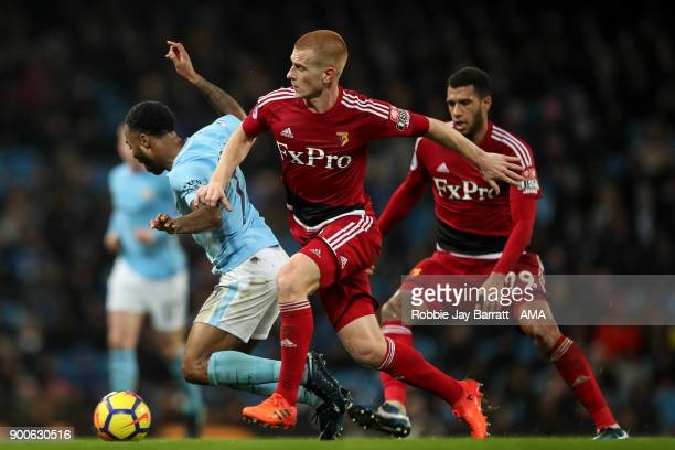 Raheem Sterling of Manchester City and Ben Watson of Watford during the Premier League match between Manchester City and Watford at Etihad Stadium on...