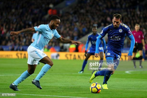 Raheem Sterling of Manchester City and Christian Fuchs of Leicester City compete for the ball during the Premier League match between Leicester City...