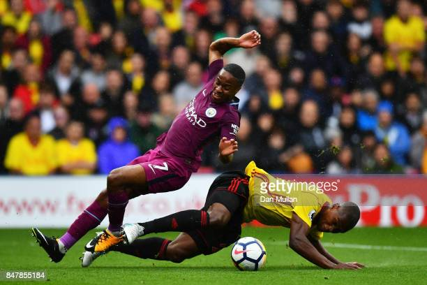 Raheem Sterling of Manchester City and Christian Kabasele of Watford battle for possession during the Premier League match between Watford and...