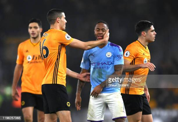 Raheem Sterling of Manchester CIty and Conor Coady of Wolverhampton Wanderers embrace after the match during the Premier League match between...