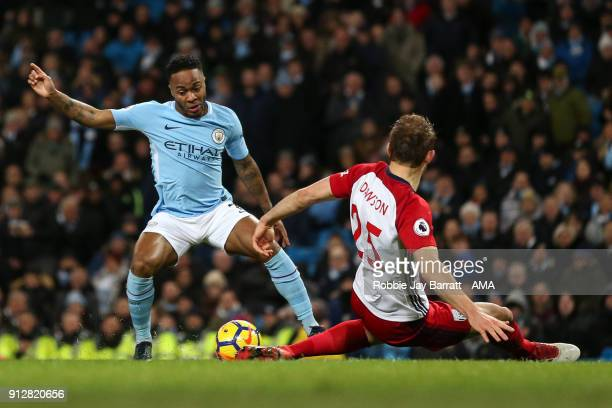 Raheem Sterling of Manchester City and Craig Dawson of West Bromwich Albion during the Premier League match between Manchester City and West Bromwich...