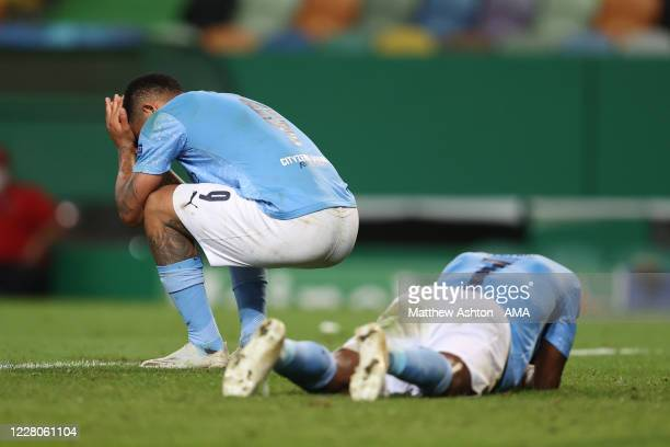 Raheem Sterling of Manchester City and Gabriel Jesus of Manchester City react at full time during the UEFA Champions League Quarter Final match...